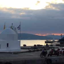 AEGINA images at sunset. St. Christos Chapel in the harbour